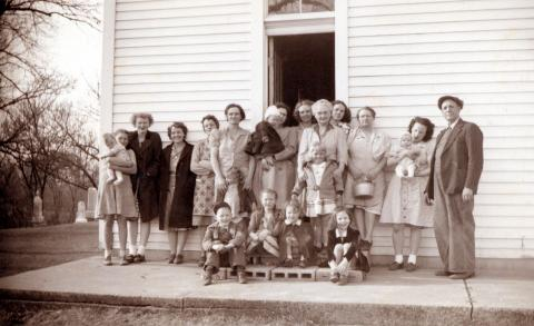 Pleasant Grove Church congregation, 1940s  From left: Helen Horness holding Hazel Horness, Rhoda Honderd, Nayda Doolittle, Ida Honderd, Elizabeth Horness, Ida Maron, ???, Mrs. Lookingbill, Berva Doolittle, Ethel Jacobs, Alma Jacobs holding Tommy, Rev. Lookingbill.  Children in front not identified.